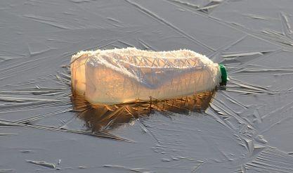 plastic milk bottle on frozen lake 1