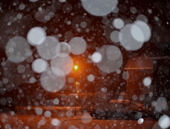 First snow falling against street light 2