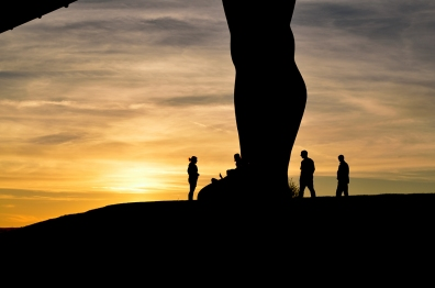 The feet of Angel of the North in silhouette