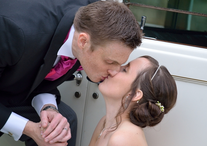 young couple kissing on their wedding day