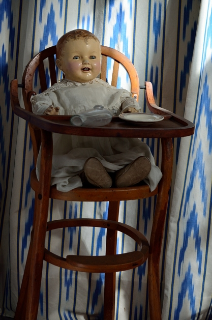 Doll in high chair..
