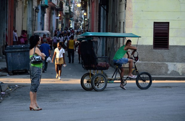 street scene in Havana with shaft of light on girl